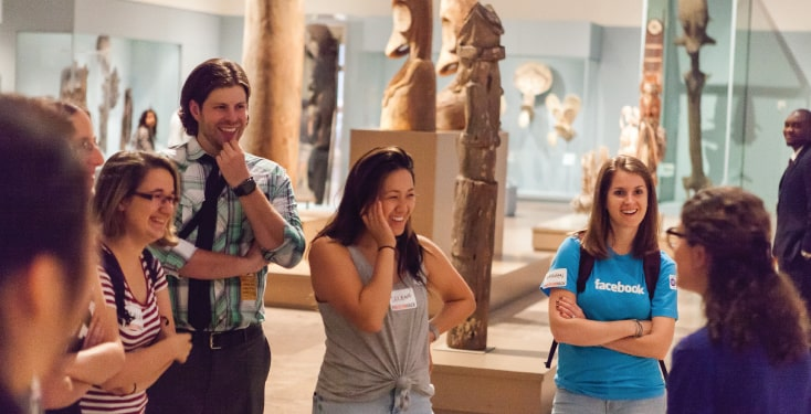 Happy guests on a team building tour at the Art Institute of Chicago.